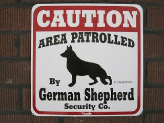 Sign CAUTION AREA PATROLLED by German Shepherd Security Co.